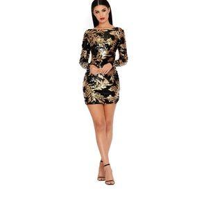 Gold black backless dress.  I